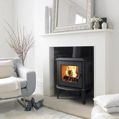 wood burner and simple white decor