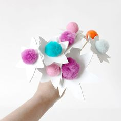 Make these POM flowers using three materials, poms, craft dowels and leather. Happy crafting!