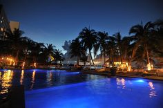 Dreams Sands Cancun - Beautiful shot of their gorgeous pool area at night!