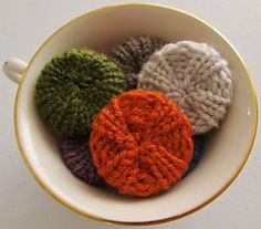 These charming miniature knitted poufs just might become an obsession, especially since there are two styles to choose from! This scrap happy project will help you use up all of those lonely little remnants that are lurking about in your yarn collection. So much fun to make – and even more fun deciding how to use all of the wonderful, colorful little poufs!