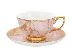 This limited edition collection 'Crystalline' has been inspired by the natural textures of crystal and stone mixed with the element of lustrous gold. Embellished in elegant 24ct gold and made from the finest quality new bone china, you will be sure to delight your guests with this classic mix-and-match range. Coordinate with an array of accessories from the Cristina Re High Tea Collection.