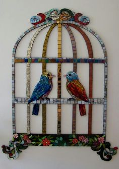 Flat bird cage (Birds in a cage) covered with mosaic