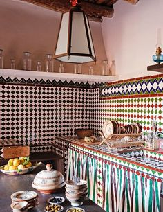 This Moroccan kitchen features traditional multicolor tiles