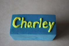 name stamps.  Write on a block, trace with hot glue or dimensional fabric paint