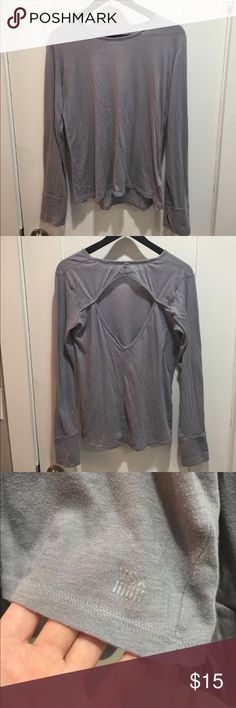 Victoria's Secret Sport Open Back Long Sleeve Tee VSX. In excellent condition. Really cute open back design Long Sleeve grey sport shirt. In size medium. Victoria's Secret Tops Tees - Long Sleeve