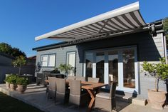 Luxaflex Motorised Garda Folding Arm Awning (in Dickson range, 8907 Gris/White) - Episode 1, Petersham NSW. Supplied by Luxaflex Window Fashions Gallery dealer A Style Of Shade, Double Bay NSW.