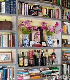 "A bookcase is designed with a mantel-like shelf ""to make it hearthlike, since we don't have a proper fireplace,"" Heekin says."