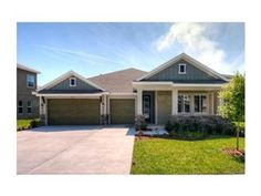6914 COVINGTON STONE AVENUE, APOLLO BEACH, FL 33572 - Listing #: T2610818 - Make this your first and last stop in looking for your new home. Your 4 bedroom, big study, large dining area off the kitchen and more is waiting for you in our newest community:
