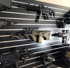 gun-room-with-wall-mounted-rifles More
