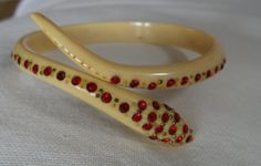 coiled snake celluloid bangle with red paste stones gorgeous by vintagebouquets on Etsy Red Rhinestone, Really Cool Stuff, Snake, Hold On, Bangles, Stones, Vintage, Etsy, Snakes