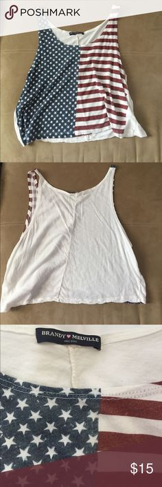 Brandy Melville American Flag Tank This American flag tank from Brandy Melville is perfect for any Fourth of July celebration or anytime of the year. Show your love for America today with this cute Tank. Brandy Melville Tops Tank Tops