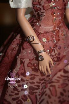 Bracelet on each arm . Handmade by Sebastian Atelier