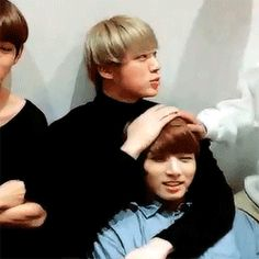Kookie looks very satisfied being the baby boy of BTS ^u^<<< just eomma things *piano playing more of making my way downtown* petting your children's heads