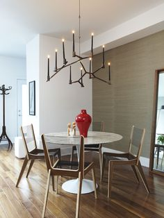 Saarinen dining table + contemporary fixture +  clean lined design by Croma
