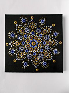 This mandala gold, silver and blue is perfect to decorate your walls!  I painted this mandala completely handmade with acrylic paints on canvas, using the technique of pointillism.  The canvas is stretched over a wooden frame. • Canvas size: 15x15mm  On the back you will find my signature.  Each piece is unique and made especially for you.  For any information please contact me.