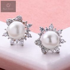 Pure silver studs with a very good design and finishing that gives an attractive look for women and girls #silver #silverjewellery #pearls #pearljewellery #zirconiastones #studs #silverstuds #beautifulearrings #silverstore #pearlearrings #silverornaments #pearlstuds #earringswithpearls #stonedearrings #earringswithstone