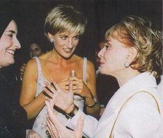 June 25, 1997: Diana, Princess of Wales conversing with Barbara Walters at Christies Auction in New York City for a gala party to launch the sale of her 79 dresses speaking to Barbara Walters.
