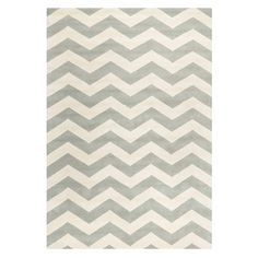 Add a pop of pattern to your breakfast nook or entryway with this hand-tufted wool rug, featuring a bold chevron motif.  Product: