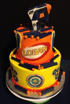 Nerf Gun and bullets are made of modeling chocolate. Tiers iced in buttercream.