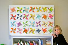 Handmade Pinwheel wall art. I may need to try this for the kids' room. It's lovely.