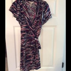 BCBG multicolor dress size extra small This is a beautiful wrap dress that fits size 0-2. From to to bottom it is 36 inches. Very comfortable and stylish dress that can be worn with boots, pumps or sandals. This is in great condition! BCBG Dresses Midi