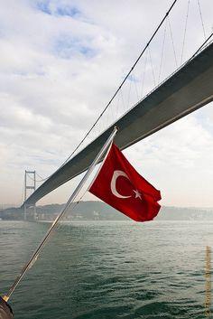 Turkish flag and Bosphorus Bridge in Istanbul..