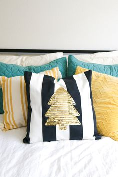 Decorate for the holidays with this very simple DIY sequin tree pillow made with sequin trim and glue! It's an easy but elegant Christmas idea.