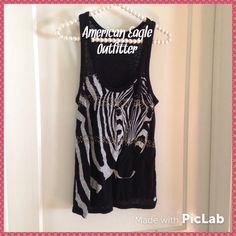 """""""Zee Best Zebra Top"""" So sweet!! Precious zebra printed tee from American Eagle Outfitters!!! 2 bands of pewter colored studs adorn the front. Slight racer back. American Eagle Outfitters Tops"""