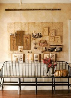 Carol Hicks Bolton wall art and wooden bench