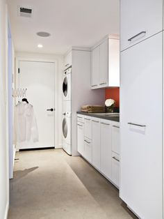 Following the same aesthetic as the rest of the home, the designers at Fiorella Design use a sleek color palette and a striking minimalist approach to bring a contemporary look to this laundry room.