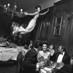 """The New York Times Melvin Sokolsky's """"Paris Pictures. The photographer's fantastical, pre-Photoshop images depict couture-clad women flying around Paris."""