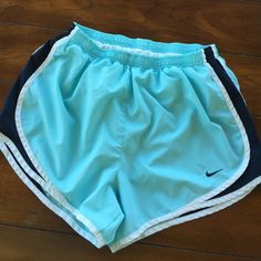 NIKE DRI-FIT shorts Medium These Nike dri-fit shorts are ladies size medium in mint, navy and white. Good condition. There is a small place in one leg where the stitching is pulled ( not a hole) and the butt has some staining but in great condition otherwise and stains will probably come out. Medium Nike Shorts