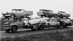 `56 Car hauler with load of `57 fords