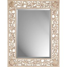 Whitewashed Coral beveled mirror designed by Malanta Knowles. Mirror size is 36h x 25w.
