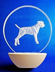 This is an LED lit night light, hand carving of a Border Terrier. Personalize it with your pet's name!
