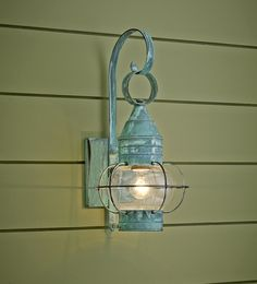 This Sandwich Lantern adds even more decorative detail to your porch with a mottled green patina finish. About $165; sandwichlatern.com