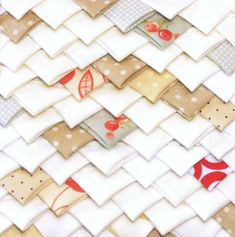 Closeup Block type:log cabin Block size:11 inches Colour scheme:reds and neutrals Texture/fabric manipulation:fabric folding Quilt size:The finished quilt is 52 1/2 x 52 1/2. Needs: one 5 inc…
