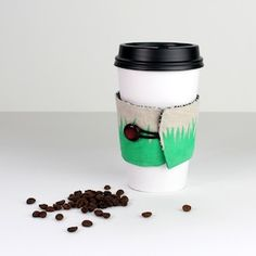Download the template and learn how to hand paint this grass pattern onto fabric and sew this fun little coffee cup holder!