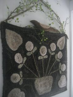 Love the way the rug is hung :: Yes! And the bird, sitting on the top, plus the color way!