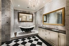 Luxurious bathroom design in black and white with a hint of gold [Design: Oswald Homes]