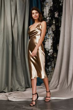 DESCRIPTION A classic below knee length bias-cut dress in a lustrous gold polyester satin. Features: Below knee length Textured polyester satin Low front cowl Double singlet straps Note: model wears size AU/UK 6 (US CONTENT Polyester Casual Formal Dresses, Elegant Dresses, Casual Dresses For Women, Pretty Dresses, Dresses For Work, Summer Dresses, Silk Formal Dress, Tailored Dresses, Classic Dresses