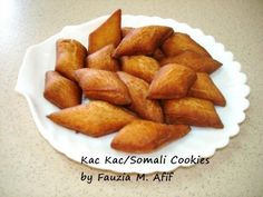 The famous Somali cookies, Ka'Ka...actually written as Kac Kac in Somali because they pronounce the letter 'c' as the arabic letter 'ain'. Really tasty crispy lil tidbits...most enjoyable with tea/coffee.
