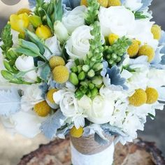 Look at this gorgeous bridal bouquet! It's made with fresh flowers and greenery except for one key ingredient- Billy Balls (Craspedia). Order dried Billy Balls for your spring bouquets (or they look great in a vase alone!) #billyballs #craspedia #weddingbouquet #springbouquet #weddingdecor #springdecor #driedflowers #homedecor #weddinginspiration
