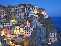 Dusk Falls on a Hillside Town Overlooking the Mediterranean Sea, Manarola, Cinque Terre, Italy Photographic Print by Dennis Flaherty at Art.com