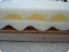 Use cheap egg foam mattress covers instead of that expensive thick foam at fabric stores -great for DIY headboards and other projects! genius!
