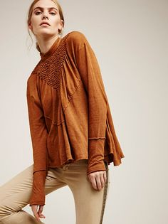 New Romantics Lena Top | Super lightweight long sleeve tee with a sophisticated high neckline and pretty smocked front detail. Unfinished edges add a cool lived-in feel. Subtle back cutout with exposed etched button closures.