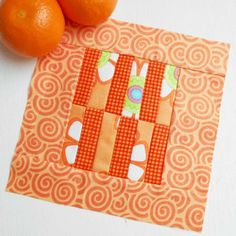 Block 174 - Tangerine.  I sliced and diced the center section by cutting three strips from two charm squares, stitching them together and then cutting them in half.