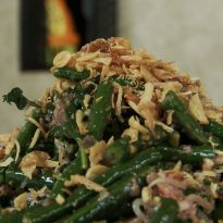 Balinese Jukut Urab is a mixed vegetable salad with beans, spinach, sprouts, grated coconut dressed in sweet and sour flavors.