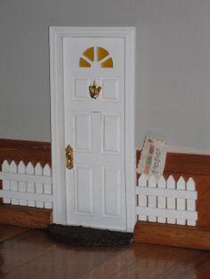 My fairy door in the dining room.     vc