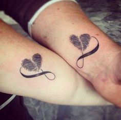 Beautiful infinity shaped couple tattoos. The infinity looping symbol is also accompanied by a heart shaped thumbprint which makes the design even more personalized.